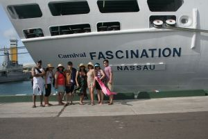 FAMILY BEHIND THE CRUISE SHIP